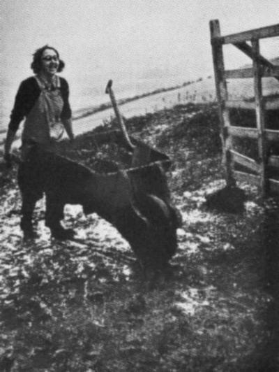 A happy 'Land Girl' of the Women's Land Army