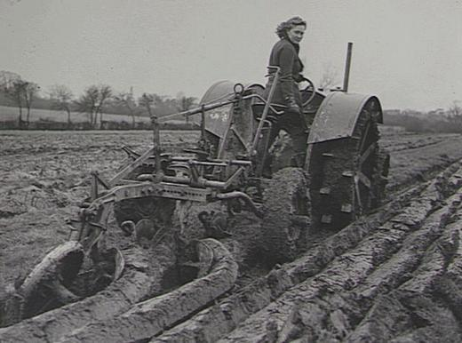 Hauling a twin furrow plough on a tractor