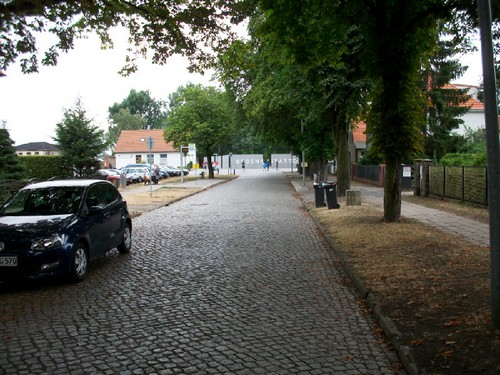The road along which thousands upon thousands of prisoners of different nationalities from different countries marched. Very few survived. In the distance, the entrance to Sachsenhausen СС Memorial can be seen.